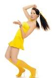Het meisje van het geslacht in een gele kleding Stock Foto