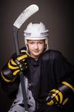 Het meisje van het hockey stock fotografie