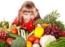 Het meisje van het kind met groep groente en fruit. Royalty-vrije Stock Afbeeldingen
