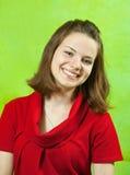 Het meisje van het portret in rode kleding stock fotografie
