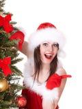 Het meisje van Kerstmis in het punt van de santahoed, spar. Stock Afbeeldingen