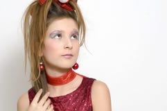Het meisje van Kerstmis in rode kleding Stock Foto's