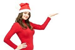 Het meisje van Kerstmis in rode santahoed stock foto
