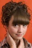 Het meisje van Nice met krullend haar Stock Foto's