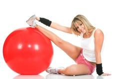 Het meisje van Pilates het uitrekken zich en geschiktheidsconcept Stock Foto