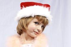 Het Meisje van Redhair in de Hoed van de Kerstman Stock Foto
