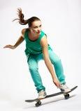 Het meisje van Skateboarder stock afbeeldingen