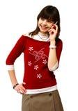 Het meisje vertelt door een mobiele telefoon Stock Foto's