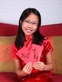 Het meisje viert Chinees Nieuwjaar stock fotografie