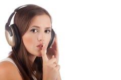 Het meisje vraagt niet verhinderen om aan het aan muziek te luisteren stock afbeeldingen