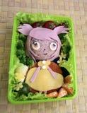 Het meisje wordt gemaakt van rijst Kyaraben, bento Stock Fotografie