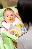 Het meisjeseetlust van de baby Stock Fotografie