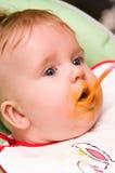 Het meisjeseetlust van de baby Stock Foto's
