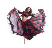 Het meisjessprong van de schoonheid in geïsoleerded zigeunerdans Stock Foto's
