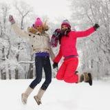 Het meisjessprong van de winter Stock Afbeeldingen