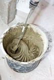 Het mengen van pleister Stock Foto