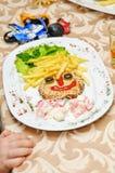Het menu van kinderen, grappige gezichten van Frieten Stock Fotografie
