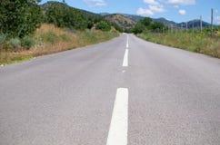 Het merken op asfalt stock foto