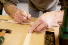 Het merken van hout Stock Foto's