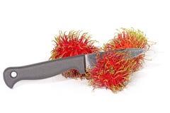 Het mes van het Rambutanfruit Stock Foto