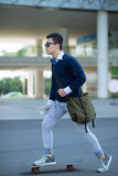 Het met een skateboard rijden van de jonge mens Royalty-vrije Stock Afbeelding