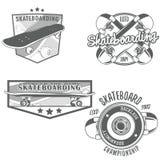 Het met een skateboard rijden van wijnoogst logotypes Stock Fotografie