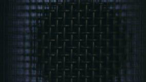 Het metaalnetwerk van de close-upmicrofoon in veranderend licht