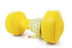 Het meten van band met gele barbell Royalty-vrije Stock Foto