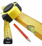 Het meten van band, niveau en potlood Stock Foto's