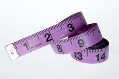 Het meten van band op witte achtergrond Royalty-vrije Stock Afbeeldingen