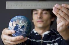 Het meten van de aarde Stock Fotografie