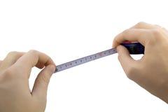 Het meten van handen stock afbeelding