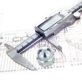Het meten van metaalnoot Stock Foto