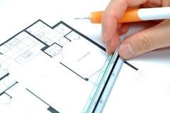 Het meten van uw nieuw huis Stock Foto's