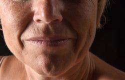 Het midden oude close-up van het vrouwengezicht stock afbeelding