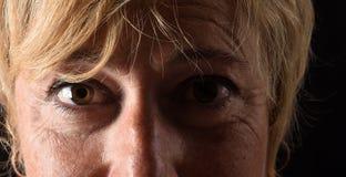 Het midden oude close-up van het vrouwengezicht royalty-vrije stock foto's