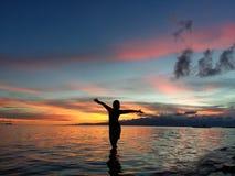 In het midden van zonsondergang stock fotografie