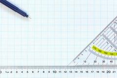 Het millimeterpapier van de techniek met heerser en pennen Stock Afbeelding