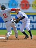 Het minder belangrijke honkbal dat van de Liga het dubbele spel draait Stock Afbeeldingen
