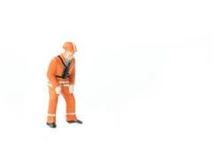 Het miniatuurconcept van de de arbeidersbouw van de menseningenieur Stock Foto