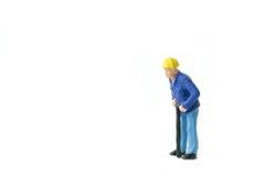 Het miniatuurconcept van de de arbeidersbouw van de menseningenieur Stock Afbeelding