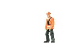 Het miniatuurconcept van de de arbeidersbouw van de menseningenieur Royalty-vrije Stock Afbeelding