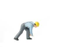 Het miniatuurconcept van de de arbeidersbouw van de menseningenieur Royalty-vrije Stock Foto