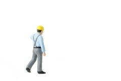 Het miniatuurconcept van de de arbeidersbouw van de menseningenieur Stock Afbeeldingen
