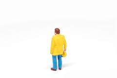 Het miniatuurconcept van de de veiligheidsbouw van de mensenarbeider op witte bac Royalty-vrije Stock Afbeelding