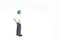 Het miniatuurconcept van de de veiligheidsbouw van de mensenarbeider op witte bac Stock Afbeelding