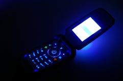 Het mobiele bellen in dark Stock Foto