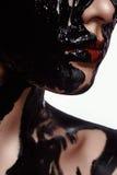 Het Model van de manierschoonheid met zwarte Inkt op Huid stock foto's