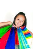 Het mooie Aziatische meisje met pakketten Stock Fotografie