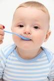 Het mooie baby eten Stock Fotografie